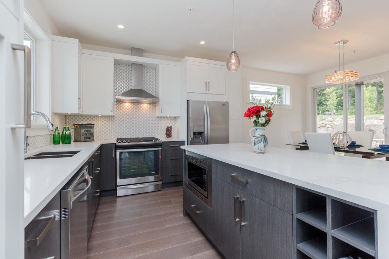 Kitchen with granite and stainless appliances River Rock Place