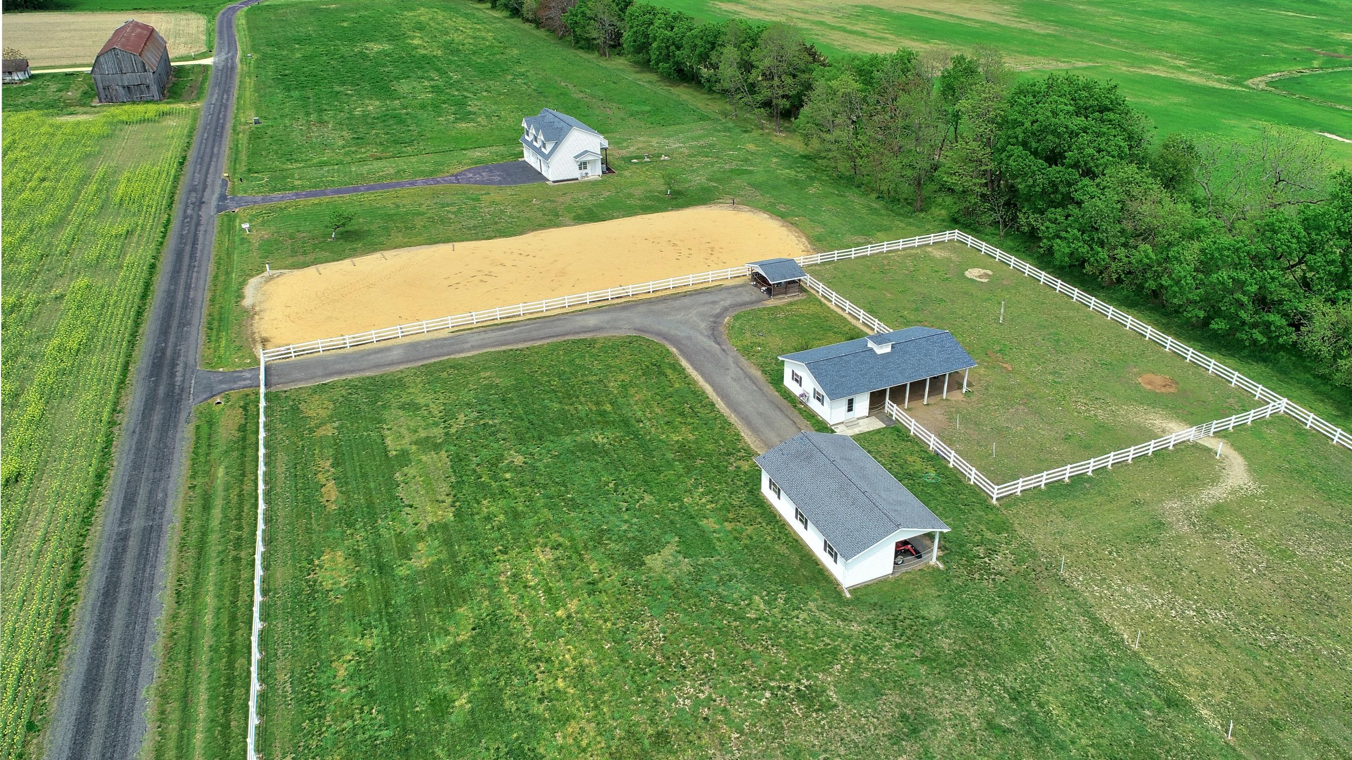 21581 Montfort Road in Bushwood MD offers horse facilities including a horse barn, ring, fenced pastures and More!  This Southern Maryland Horse Farm is a waterfront home in Saint Marys County! Call Marie Lally, Your Southern Maryland Realtor!