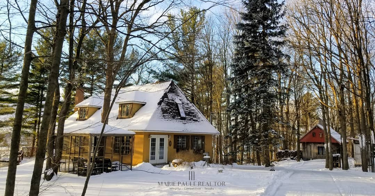 This beautiful Normandy-style home sits perched above wheat fams to the South, on an agricultural lot of 4.4 acres, part of which is a maple grove.