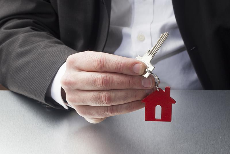 professional giving a key to your property