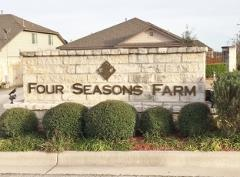 Sign at the entry to Kyle's Four Seasons Farm subdivision 78640