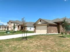 A view of homes in the Woodlands Park subdivision in Kyle, Texas.