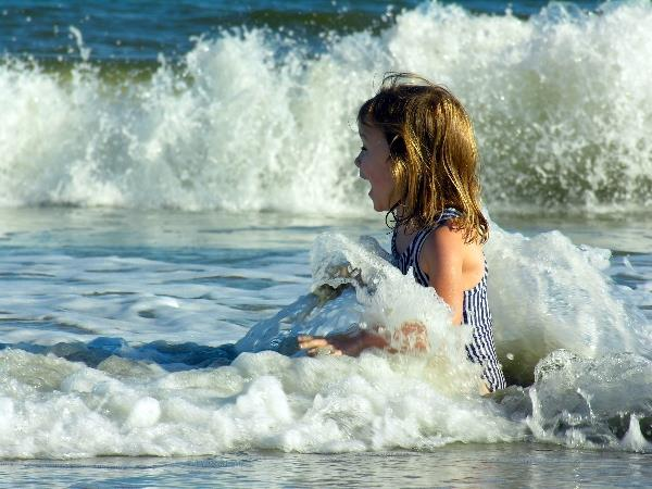 Girl playing in an Atlantic Ocean wave at a SC beach
