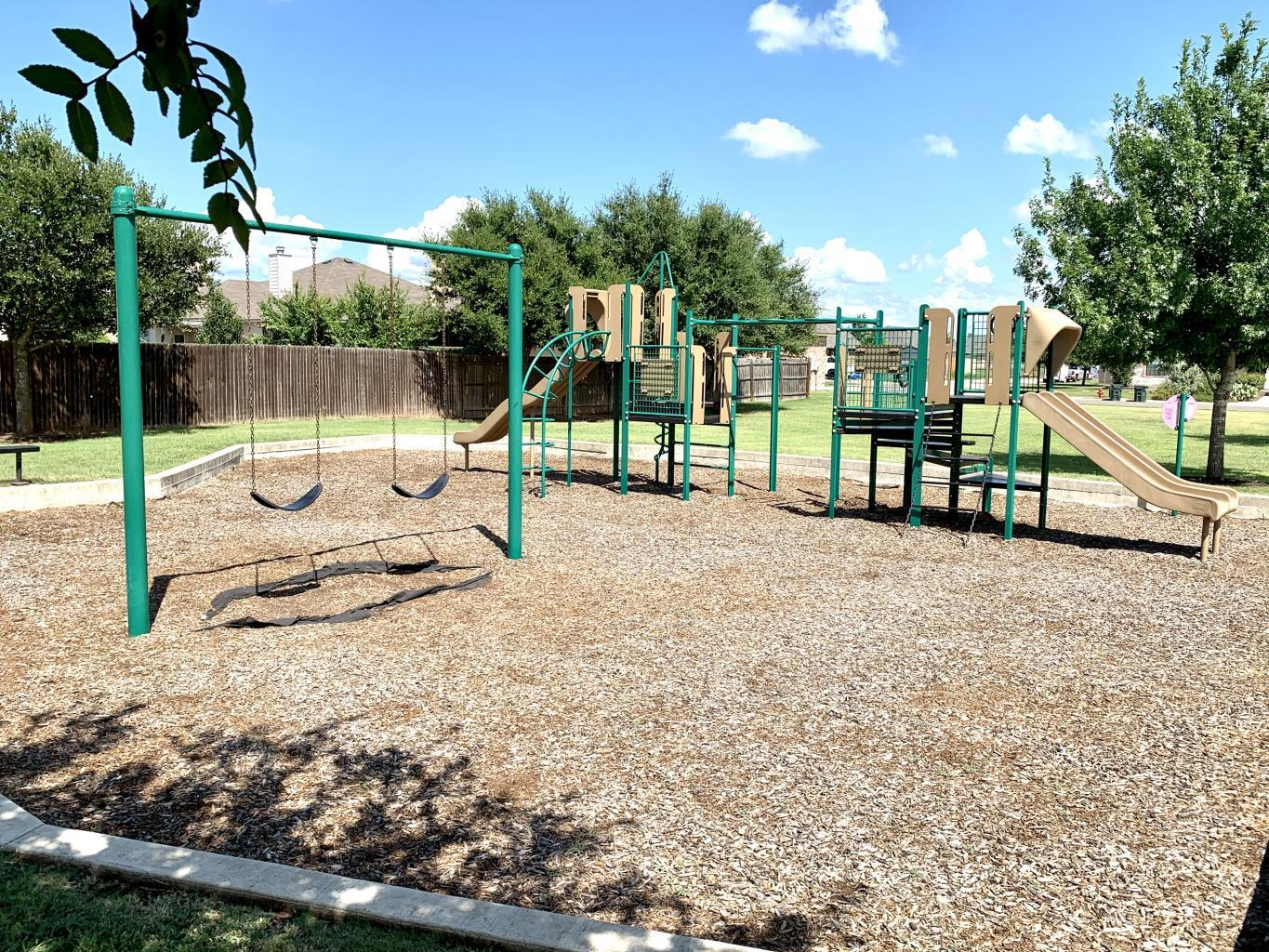 The playground in Woodlands Park, Kyle, Texas.