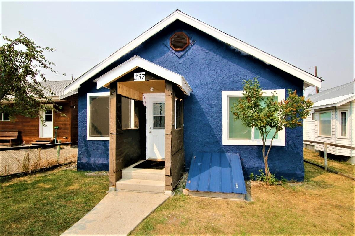 blue stucco sided house