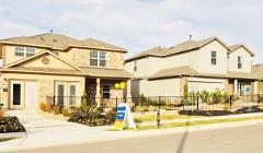 A view of model homes in the Reserve at McKinney Falls neighborhood in Austin 78744