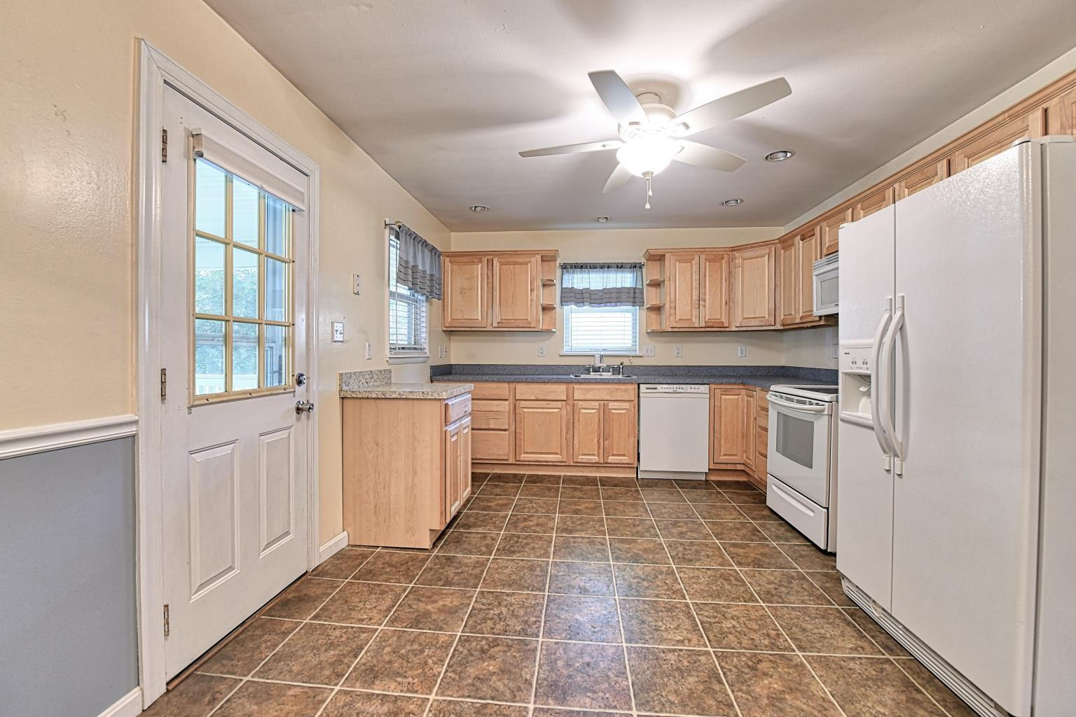 Spacious Kitchen in 29783 Skyview Drive - A Charming Rambler for Sale in Southern MD offering Affordable Taxes, Beach Access and More!  Call Realtor, Marie Lally, at 301-748-8698 for more information!