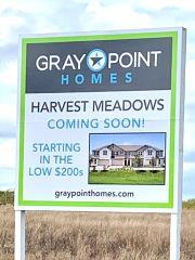 Temporary sign at Harvest Meadows Townhomes in Buda 78660
