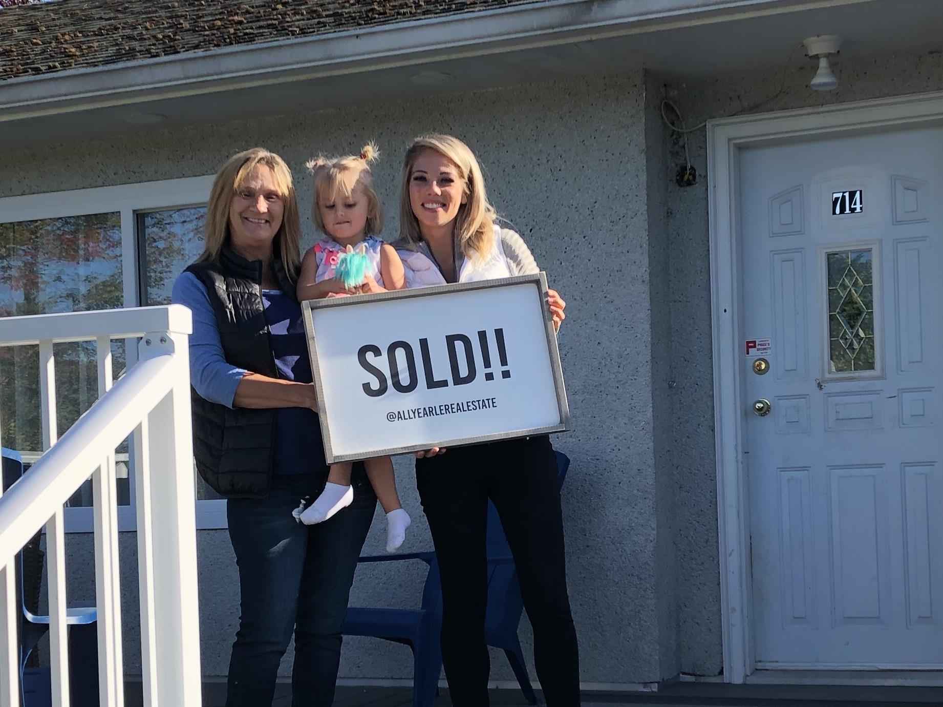 Ally Earle, REMAX Lake Cowichan, stands with another satisfied customer!