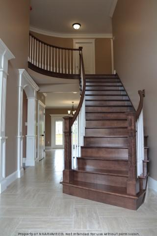 Custom features in a new home - curved staircase and wall - Halifax real estate