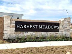 Sign at Harvest Meadows Townhomes in Buda 78660