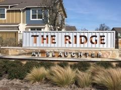 Sign at the entrance to The Ridge at Slaughter Condos in South Austin
