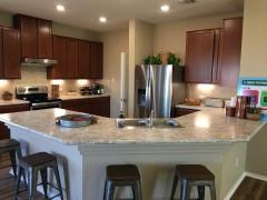 A model home kitchen in the Highlands at Grist Mill.