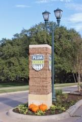 Sign at the entry to the Plum Creek subdivision in Kyle, Texas.