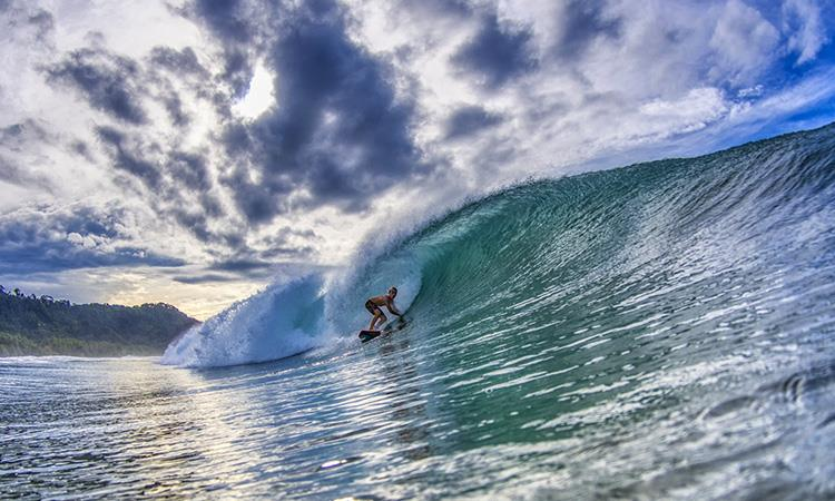 Surfer catching a wave at Dominical Costa Rica