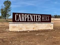 The sign at the entry to the Carpenter Hill neighborhood in Buda.