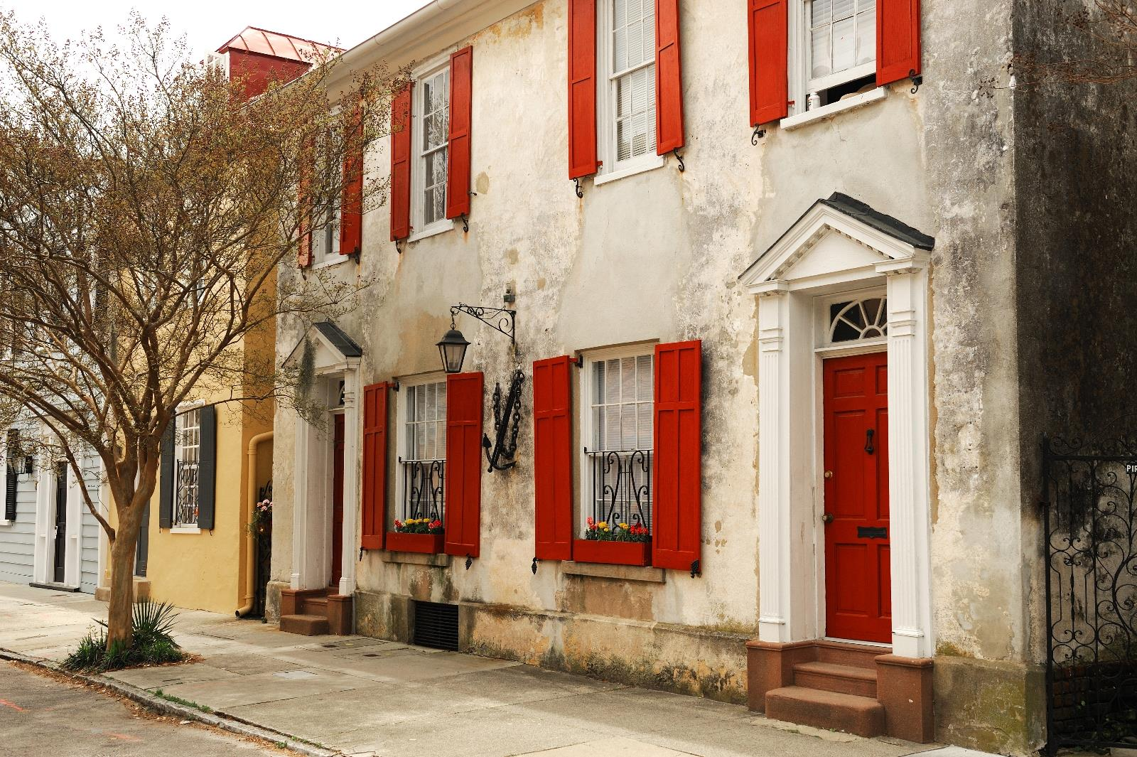 iconic historic Charleston home with handsome red shutters