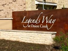 Sign at the entry to the Legends Way at Onion Creek neighborhood