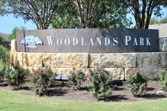 Sign at the entry to Kyle's Woodlands Park subdivision 78640