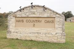 A view of the the western-side entry to Hays Country Oaks in Buda, 78610.