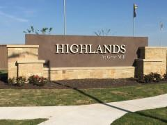 Sign at the entrance to the Uhland-Kyle Highlands at Grist Mill subdivision 78640