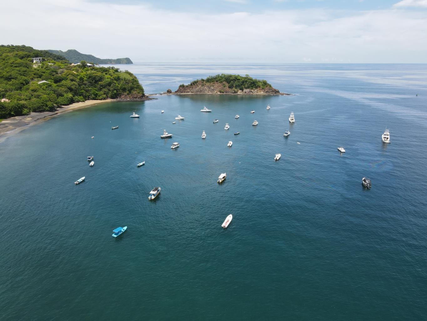 Boats nestled in the bay off of Playa Ocotal