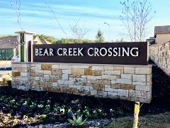 Sign at the entrance to Bear Creek Crossing in South Austin.