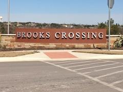 Sign at the entry to the Brooks Crossing community in Kyle, Texas.