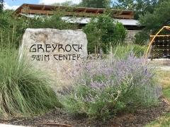 A view of the Greyrock Ridge amenity center sign