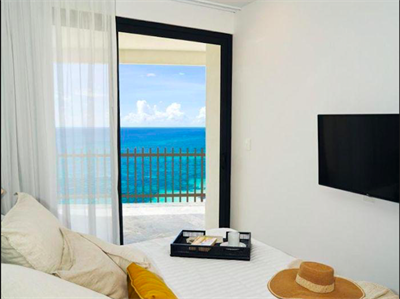 Exclusive Location 2 Br. Beachfront Condo w/ Private Terrace in Coco Beach, Immediate Delivery