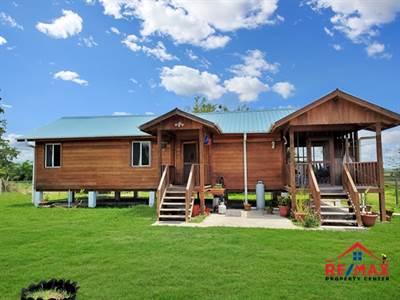 #4046 - Belizean Hardwood Two Bedroom Home with Room for Gardening