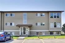 Condos for Sale in Big Springs, Airdrie, Alberta $105,000