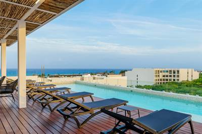 Stylish 1 Br condo Steps From The Beach, Downtown, Playa del Carmen