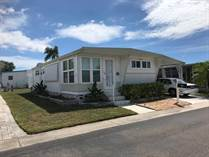 Homes for Sale in Honeymoon MHP, Dunedin, Florida $65,000