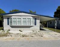 Homes for Sale in Whispering Pines, Largo, Florida $55,000