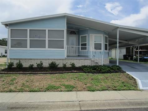 Home for Sale in Forest Lake Estates, Zephyrhills, Florida $49,900