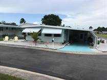 Homes for Sale in Honeymoon MHP, Dunedin, Florida $74,900