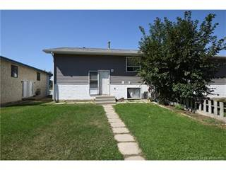 Multi-family Home for sale in 59 Ingram Park Drive E, Brooks, Alberta