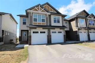 Multi-family Home for sale in 101 Sunset Dr, Cochrane, Alberta
