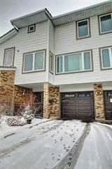 Condo for sale in 223 COACHWAY LN SW, Calgary, Alberta